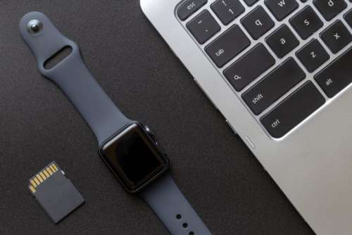 Smartwatch and Laptop Free Photo