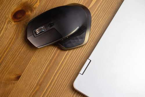 Mouse and Laptop on Desk Free Photo