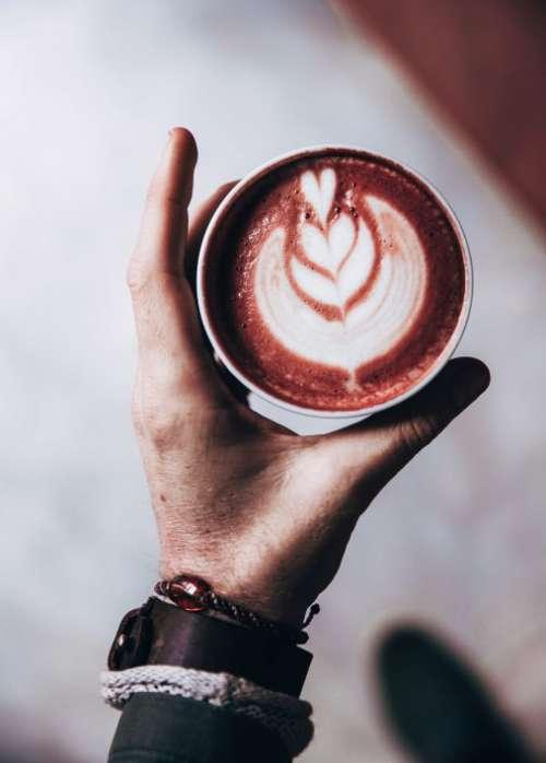 Latte Art in Hand Free Photo