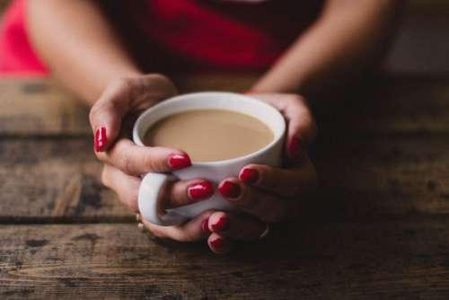 Woman Holding Coffee Free Photo