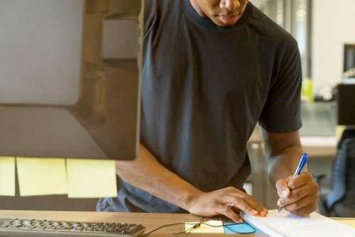 Man Taking Notes Computer Free Photo