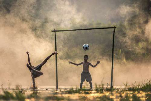 Boys Playing Football Free Photo