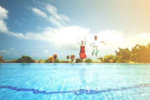 Man Woman Jumping Pool Free Photo