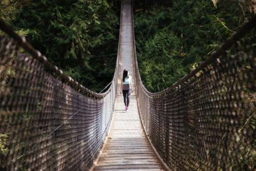 Woman Walking Swing Bridge Free Photo