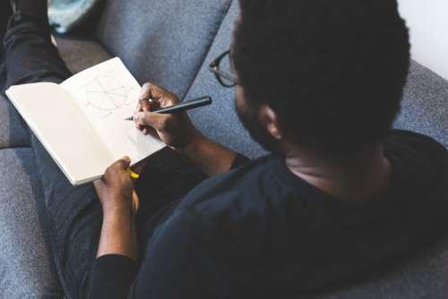 Man Sketching Notepad Free Photo