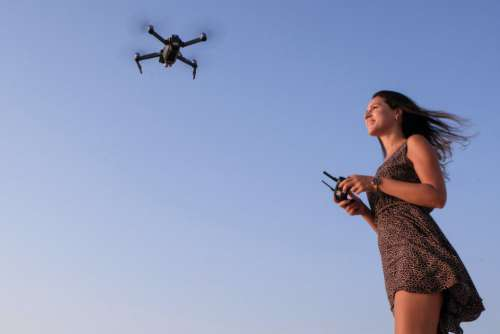 Woman Flying Drone Free Photo