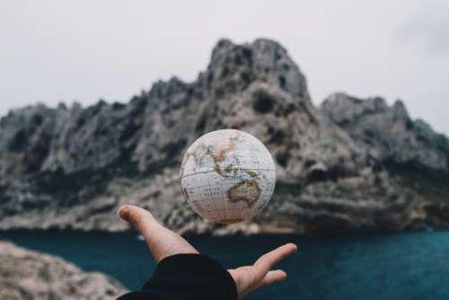 Man Throwing Globe Free Photo