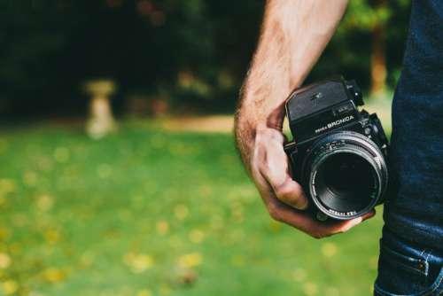 Man Holding Camera Free Photo