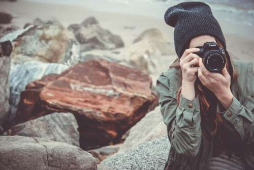 Woman Camera Hat Rock Outdoors Free Photo