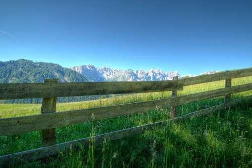 Green Fields Fence Mountain Blue Sky Free Photo