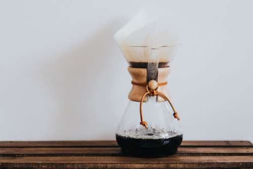Pouring Hot Coffee Maker Free Photo