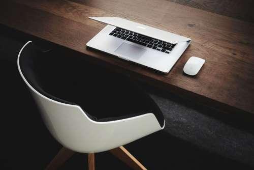 MacBook on Wooden Desk Free Photo