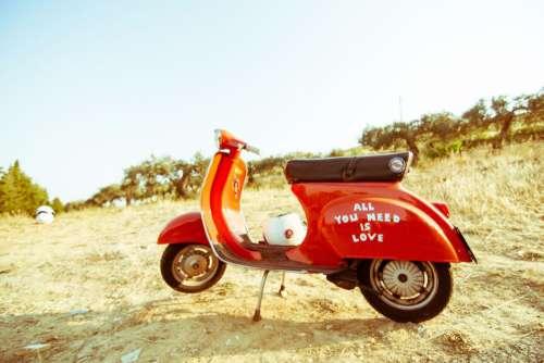 Vintage Red Vespa Beach Free Photo