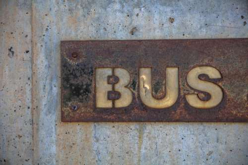 Rusty Bus Sign Wall Free Photo