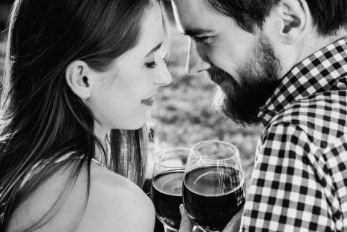 Woman & Man Drinking Red Wine Free Photo