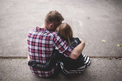 Young Couple Cuddling Free Photo