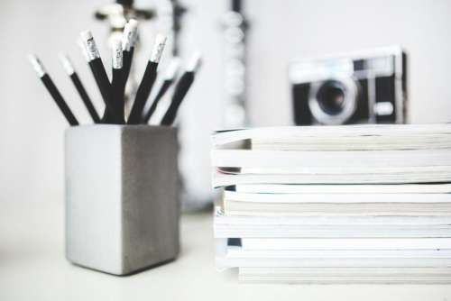 Desk With Pencils & Magazines Free Photo