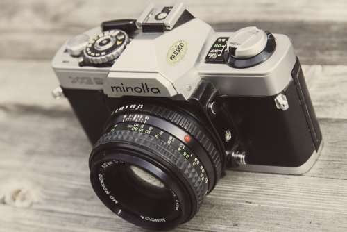 Minolta Camera on Wooden Surface Free Photo