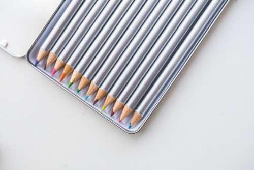 Colored Pencils in Box Free Photo