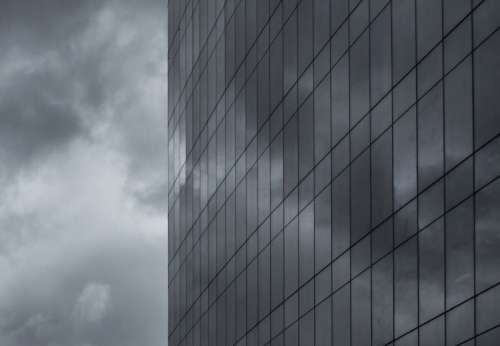 Clouds Reflecting on Skyscraper Free Photo