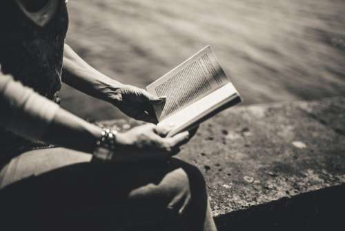 B&W Woman Reading Book in Park Free Photo