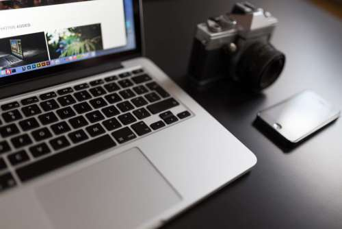 MacBook and Retro Camera Free Photo