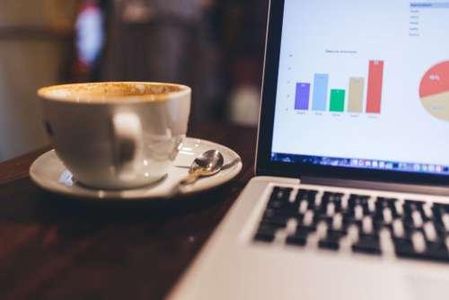 MacBook, Charts and Coffee Free Photo