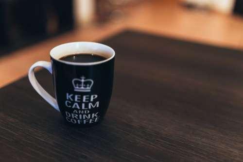 Black & White Coffee Mug on Desk Free Photo