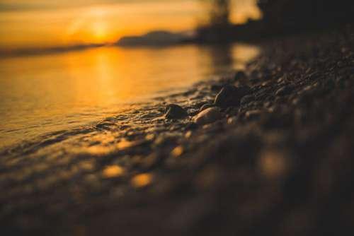 Sea Stones Shore Sunset Free Photo