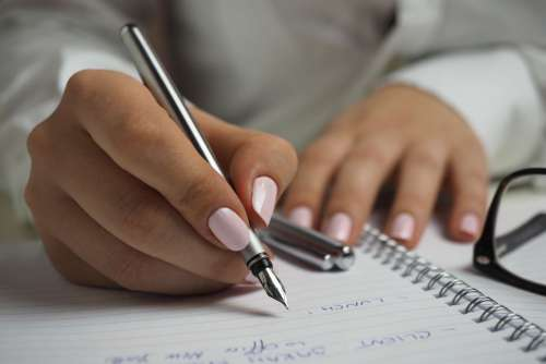 Woman Writing Notepad Free Photo