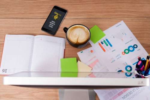 Coffee, Paper Charts & Notepad Free Photo