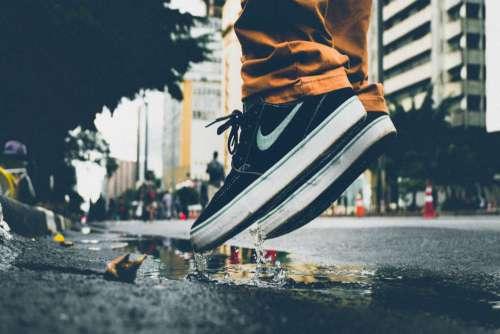 Man Jumping Puddle Nike Free Photo