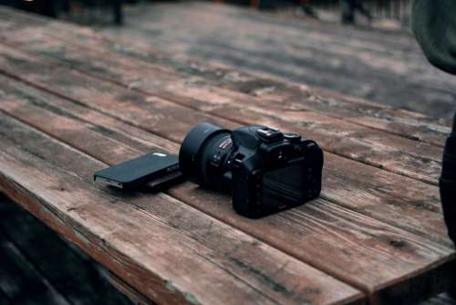 Dslr Camera Mobile Wood Table Free Photo