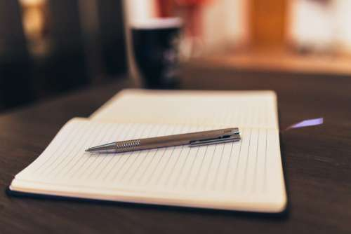 Coffee, Notebook and Pen Free Photo