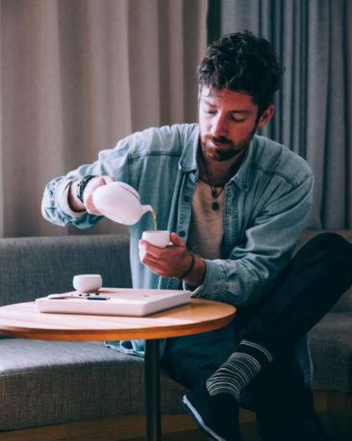 Man Pouring Tea Free Photo