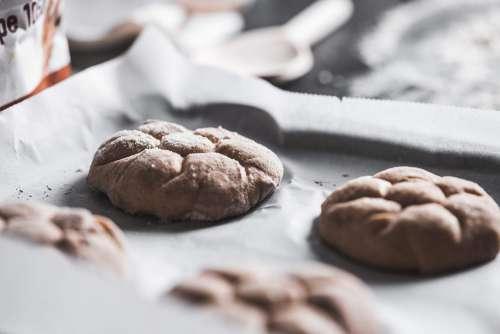 Preparing Homemade Kaiser Roll for Baking Free Photo