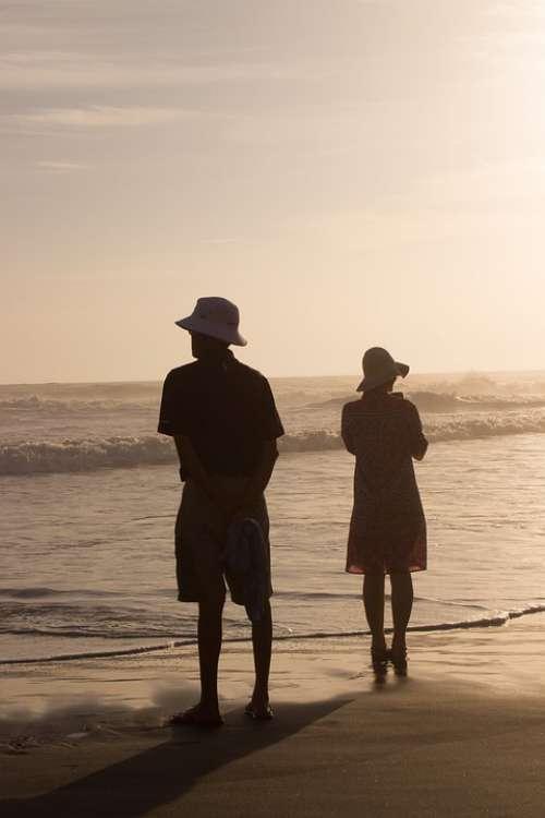 Couple Beach Sunset Golden Hour Hat Love Sea