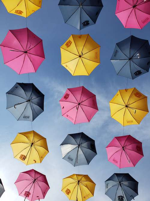 Umbrellas Sky Yellow Blue Magenta Sunshine Clouds