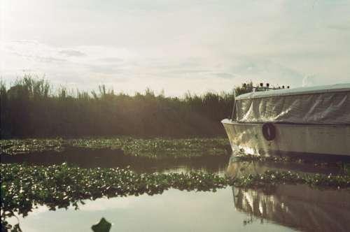 boat lake light sun water
