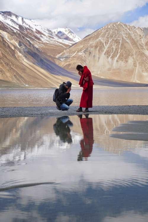 Buddhist man pay respect to monk at Pangong lake, Ladakh, Jammu and Kashmir, India.
