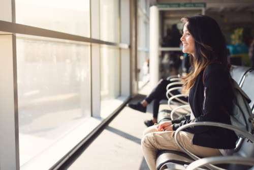 Teenage girl waiting at airport lounge