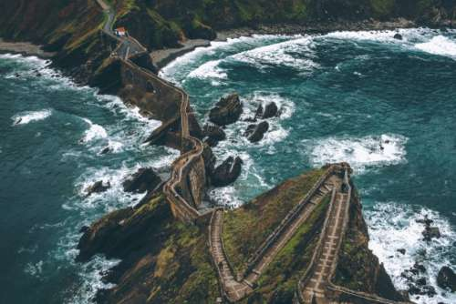 Dragonstone. Top view of stairs and bridge to an island. Wanderlust in remote places.