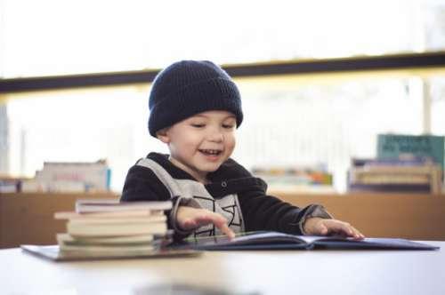 little boy reading a book..