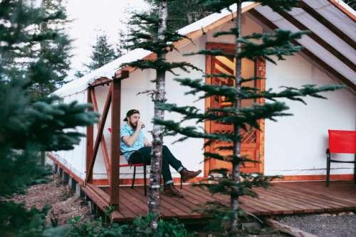 Young stylish man cabin camping