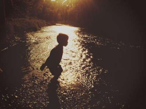 Rock throwing in the creek
