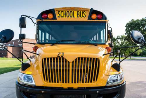 Front view of a school bus -   Bus line up, back to school, pick up, drop off, high school, junior high, middle school, elementary, grade school, public school, transportation, field trips, sporting events, team, band, kids, teens, students  💫💲