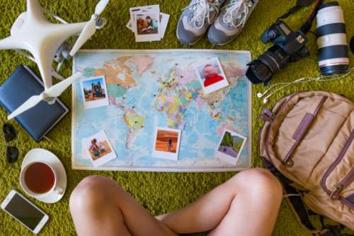 Travel set with camera, drone and map