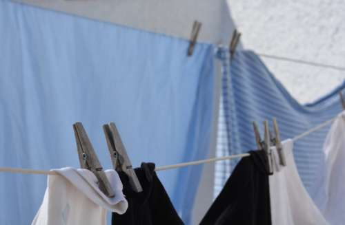 Laundry day. Laundry hanging on the washing line to dry.