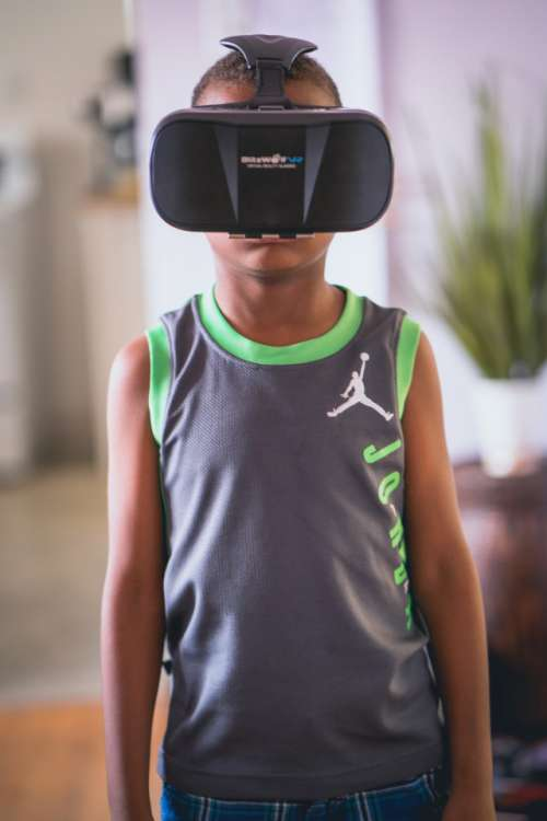 Little boy wearing virtual reality goggles