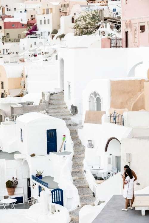 Travellers Tourist Girls Watching Their Smartphone On Famous Greek Island Santorini
